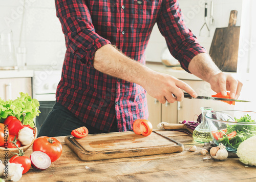 Man cooking healthy food in kitchen at home
