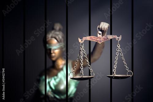 Lady Justice against jail background Canvas Print