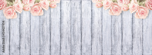 Fotografie, Obraz  Roses on background of shabby wooden planks with place for text.