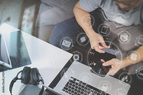 Fototapeta hipster hand using smart phone and laptop compter,digital tablet obraz na płótnie