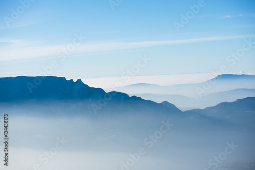 Aluminium Prints Blue beautiful french alps winter panoramic aerial view landscape with a fantastic blue haze cloudy mountain background
