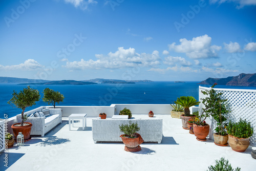 Canvas Print Comfortable sofa on the balcony with view of Santorini