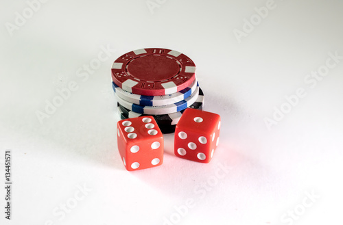 Foto  Gambling chips and dice on a white background