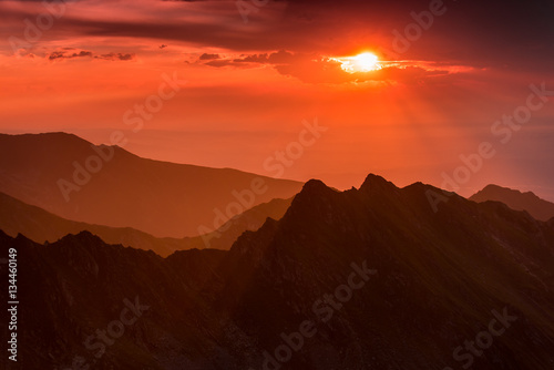 Recess Fitting Sunset Colored sunset over the Fagaras Mountains