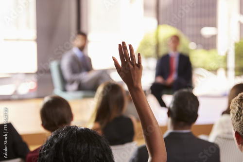 Hand in audience raised for a question at a business seminar Wallpaper Mural