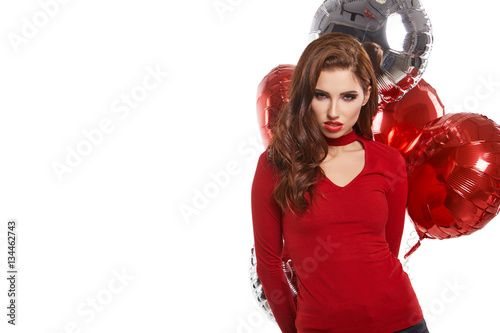 Photo  beautiful young woman with red and silver balloons. Valentines d