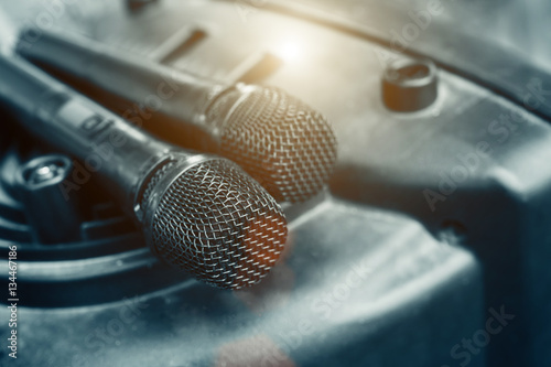Microphone in soft focus placing on audio synthesiser