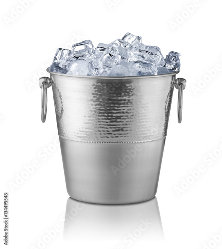 Metal champagne bucket, full with ice. Isolated on white Wall mural