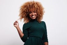 Smiling Black Woman Have Fun With Her Cyrly Blonde Hair