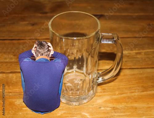 Fotografie, Obraz  Portrait of depressed man and empty beer glass