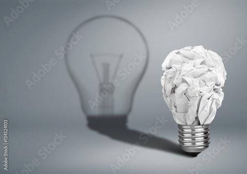 Fototapeta Bulb with crumpled paper and shadow, Idea creative concept obraz na płótnie