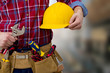 the construction worker and technician on background