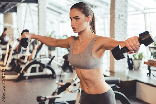 Photo sur Toile Fitness Woman at the gym