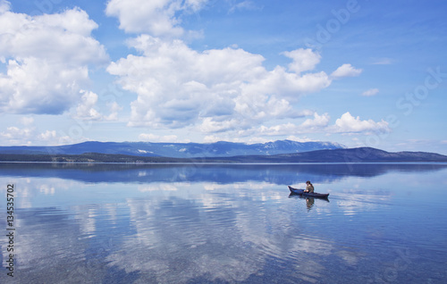 Valokuva  Cloud Reflections with Kayaker