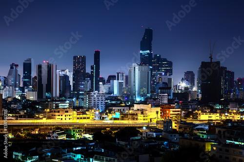 Beautiful night city, Modern night cityscape of Bangkok Thailand, urban and street in the night, futuristic architecture nighttime illumination.