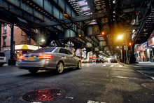 Above Ground Subway Line And New York City Street In Brooklyn With Cars. City Backround.