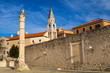 Pillar of shame and St.Elias's church on the Roma Capitolium in Zadar. Croatia.