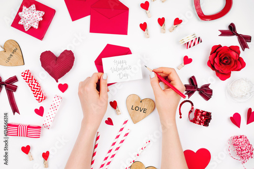 Women S Hands Holding Valentine Card On White Background With
