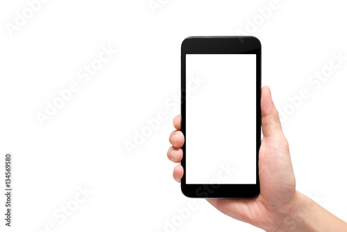 Fotografía  Hand holding black mobile phone with blank screen isolated on wh
