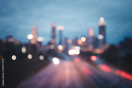 Bokeh lights of modern city night skyline - 134574791