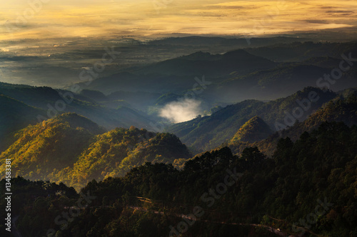 Deurstickers Afrika Landscape in Doi Ang Khang Chiang Mai Thailand with misty morning sunrise over mountains.