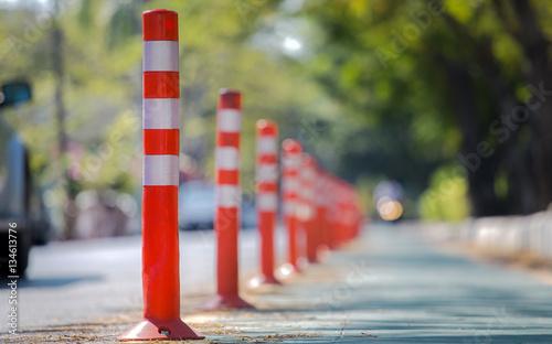 Fotografía  Orange traffic reflective bollards