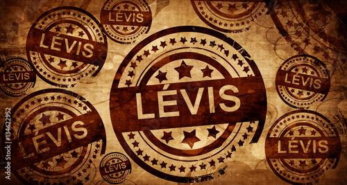 Photographie  Levis, vintage stamp on paper background