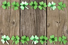 St Patricks Day Double Border Of Handmade Paper Shamrocks Over A Rustic Wood Background