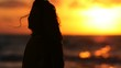 woman in the sunset with silhouette