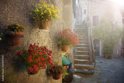 Spring streets of the old Tuscan town. Colorful flowers bloom an © Jarek Pawlak