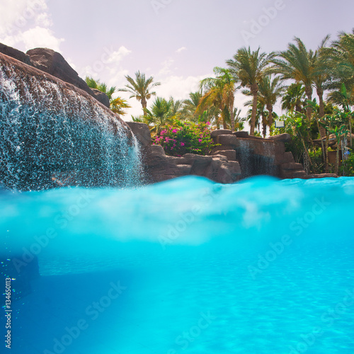 Photo Stands Turquoise nice view of the swimming pool with waterfall