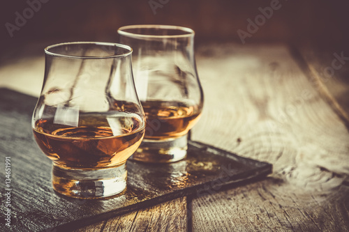 Whiskey with ice in glasses Canvas Print