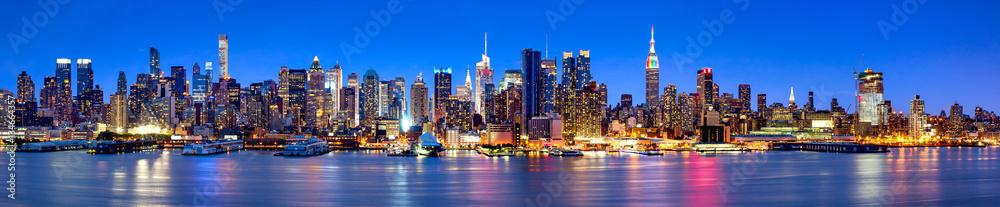 Fototapeta Manhattan Skyline Panorama bei Nacht