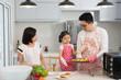 asian family baking at kitchen