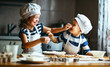 Leinwandbild Motiv happy family funny kids bake cookies in kitchen