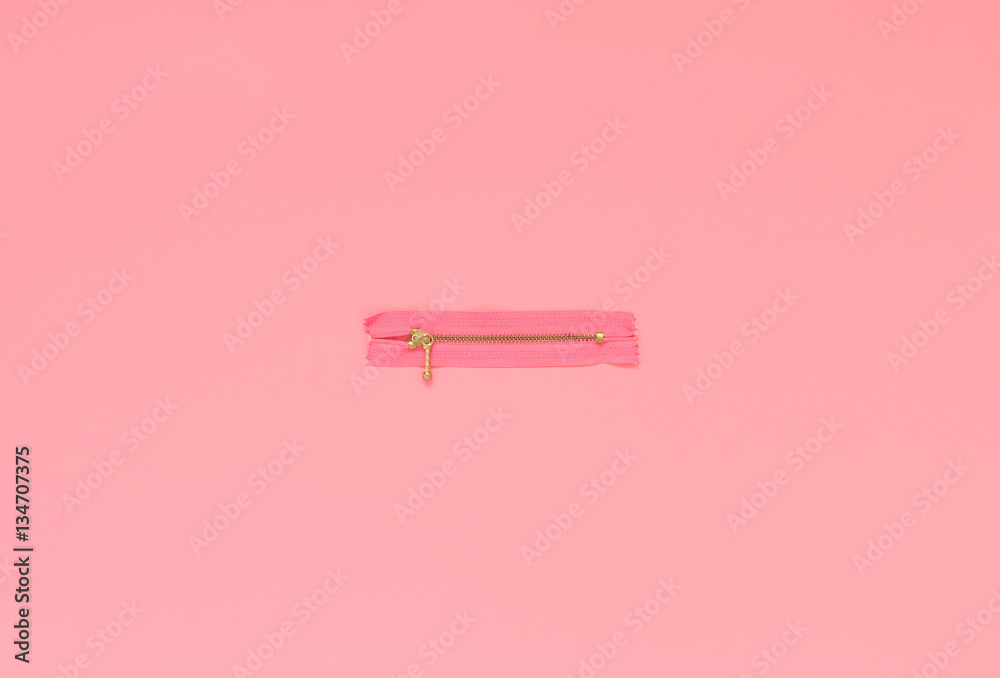 Fototapety, obrazy: Pink zipper on a pink background. Flat lay concept, top view.