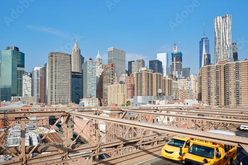 Foto op Plexiglas New York TAXI New York city skyline from Brooklyn Bridge, yellow taxi passing