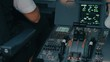 Close shot inside cockpit of Airbus A319 A320 A321. Flight deck and pedestal. First pilot officer enter data by multipurpose control display unit MCDU