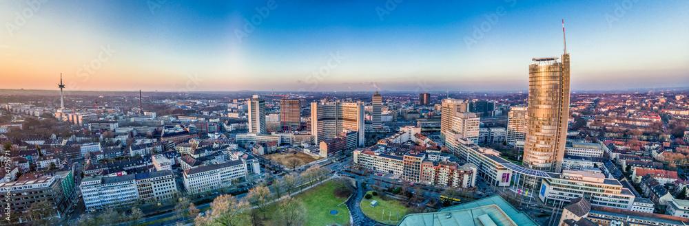 Fototapety, obrazy: The city skyline of Essen under the sunset