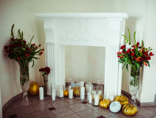 The Candles,vases And Melons Stand Near Fireplace