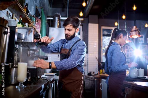 Barman barista uniform making coffee tea cocktails in the bar, restaurant, shop Wallpaper Mural