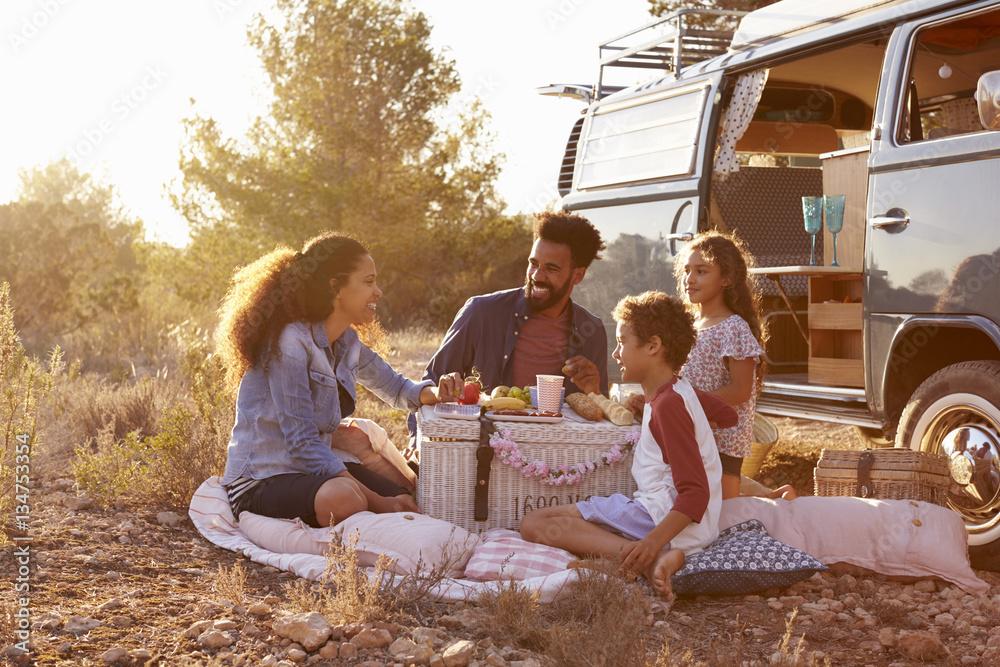 Fototapety, obrazy: Family having a picnic beside their camper van, full length