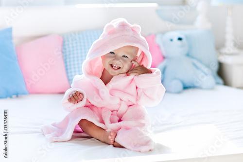 Fotografie, Obraz  Baby in bathrobe or towel after bath