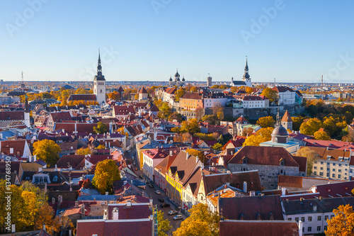Foto op Plexiglas Oude gebouw Classic panoramic view of full old Tallinn with towers, red roofs, churches and castle. Aerial view, autumn season