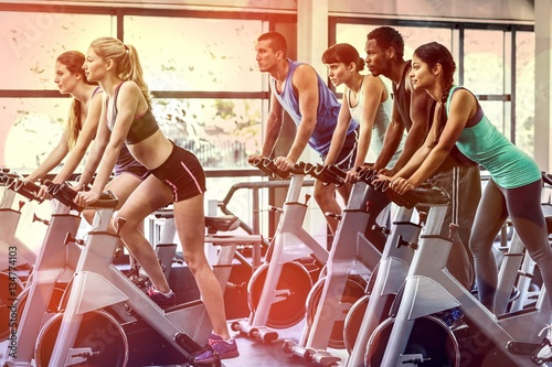 Fit people working out at spinning class Wallpaper Mural