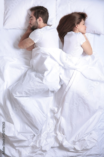 Photo  Young cute couple together in bed