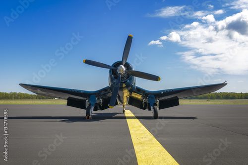 Poster  Chance Vought F4U Corsair on static display, front view from bel