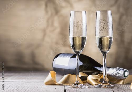 Fotografie, Obraz  two champagne glasses and bottle,valentines day