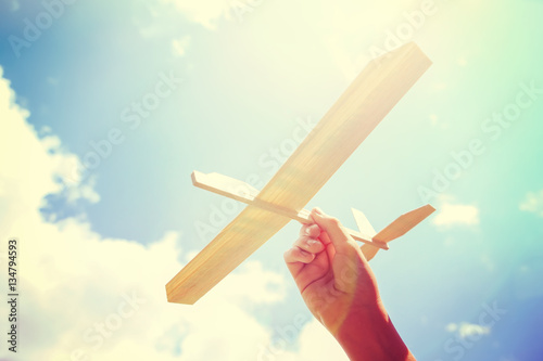 Toy balsa wood airplane in the sky. Toned filtered Instagram ima Canvas Print