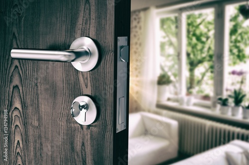 Obraz Composite image of brown door with metal doorknob and lock - fototapety do salonu